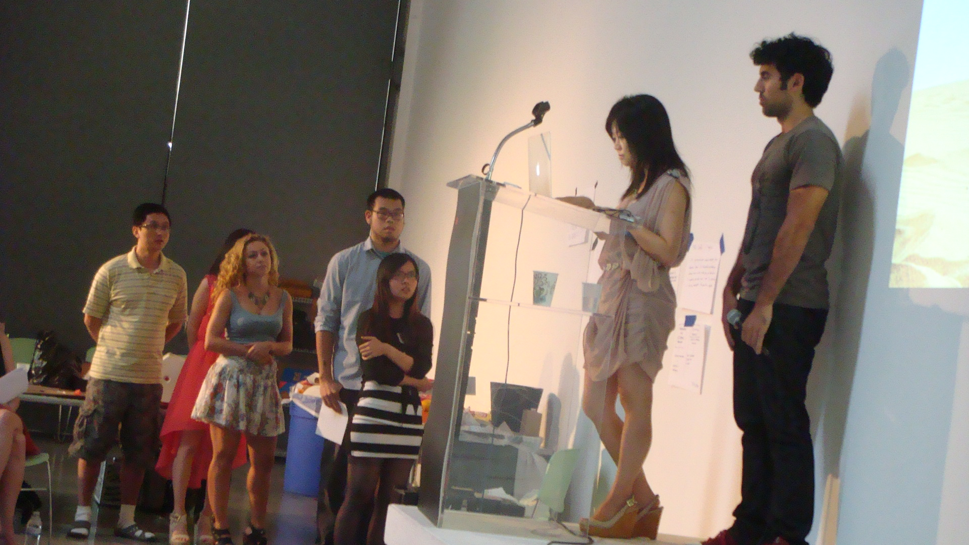 The Compass H2O team standing on stage and next to the stage as the presentation begins